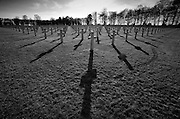 """St Mihiel American Cemetery and Memorial, Thiaucourt,Saint-Mihiel Salient Battlefield France. March 2014<br /> The cemetery, 40.5 acres (16.4 ha) in extent, contains the graves of 4,153 of American military dead from World War I. The majority of these died in the offensive that resulted in the reduction of the St. Mihiel salient that threatened Paris. The burial area is divided by Linden alignment trees and paths into four equal plots. At the center is a large sundial surmounted by an American eagle.<br /> The Battle of Saint-Mihiel was a World War I battle fought from 12-15 September 1918, involving the American Expeditionary Force and 48,000 French troops under the command of General John J. Pershing of the United States against German positions. The United States Army Air Service (which later became the United States Air Force) played a significant role in this action.[2][3]<br /> <br /> This battle marked the first use of the terms """"D-Day"""" and """"H-Hour"""" by the Americans.<br /> <br /> The attack at the St. Mihiel Salient was part of a plan by Pershing in which he hoped that the United States would break through the German lines and capture the fortified city of Metz. It was one of the first U.S. solo offensives in World War I and the attack caught the Germans in the process of retreating.[3] This meant that their artillery were out of place and the American attack proved more successful than expected. Their strong blow increased their stature in the eyes of the French and British forces, but again demonstrated the critical role of artillery during World War I and the difficulty of supplying the massive World War I armies while they were on the move. The U.S. attack faltered as artillery and food supplies were left behind on the muddy roads.[1] The attack on Metz was not realized, as the Germans refortified their positions and the Americans then turned their efforts to the Meuse-Argonne offensiv"""