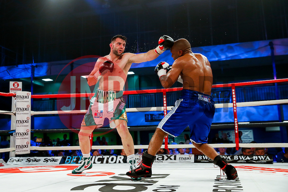David Bailey of Bristol (green, white shorts) on his way to a points victory over Elvis Dube (blue shorts) in a Light Heavyweight bout on the undercard - Photo mandatory by-line: Rogan Thomson/JMP - 07966 386802 - 13/06/2015 - SPORT - BOXING - Bristol, England - Action Indoor Sports Arena - Lee Haskins vs Ryosuke Iwasa - Interim IBF World Bantamweight Title Fight - UNDERCARD.