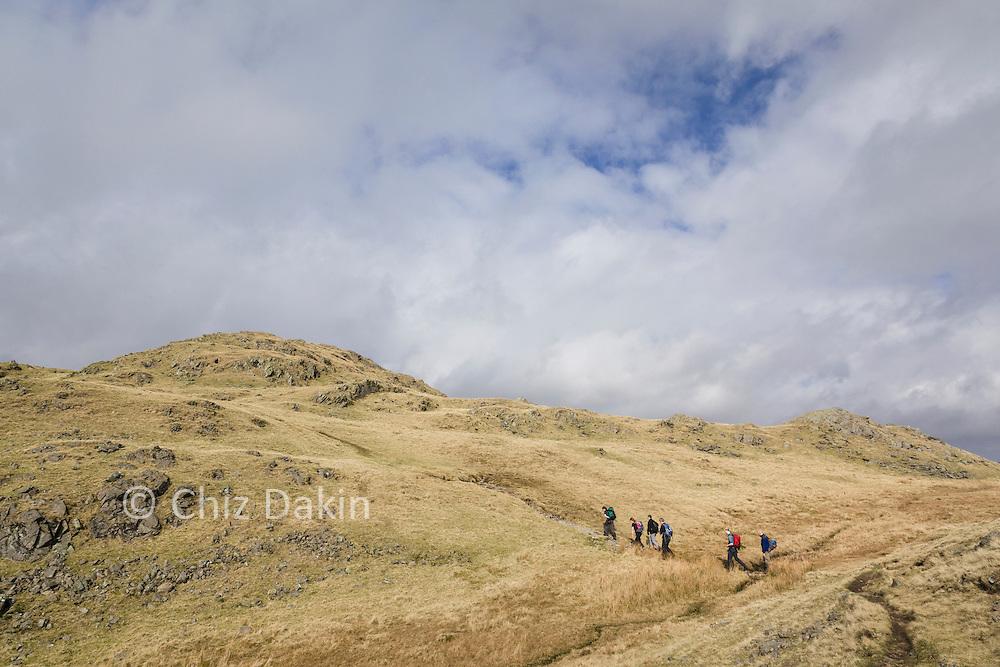 Walkers on the ridgeline near Lang How
