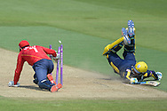 Hampshire all-rounder Liam Dawson dives in as Essex wicket-keeper James Foster tries to remove the bails during the Royal London One Day Cup match between Hampshire County Cricket Club and Essex County Cricket Club at the Ageas Bowl, Southampton, United Kingdom on 5 June 2016. Photo by David Vokes.