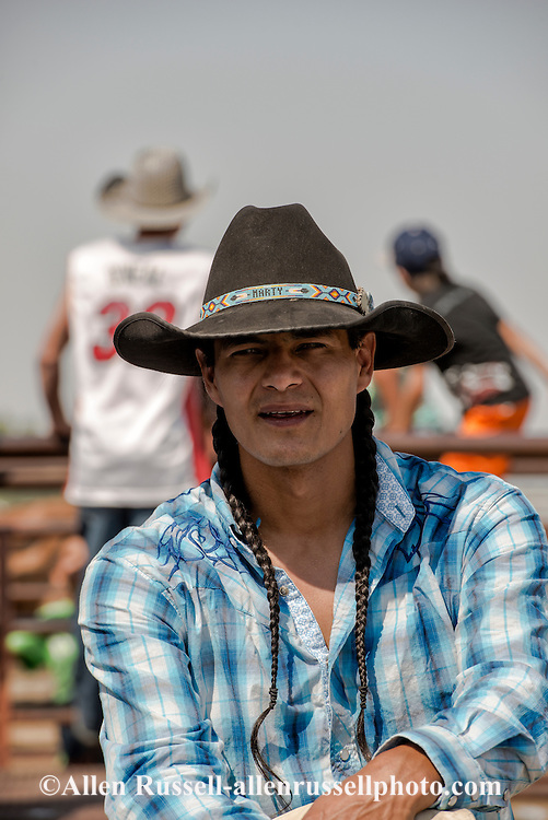 Saddle Bronc rider, Marty Young Bear, Three Affiliated Tribes, Crow Fair Rodeo, Crow Indian Reservation, Montana