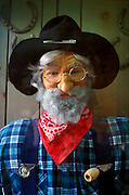 Old Americana doll miner with a beard and a pipe