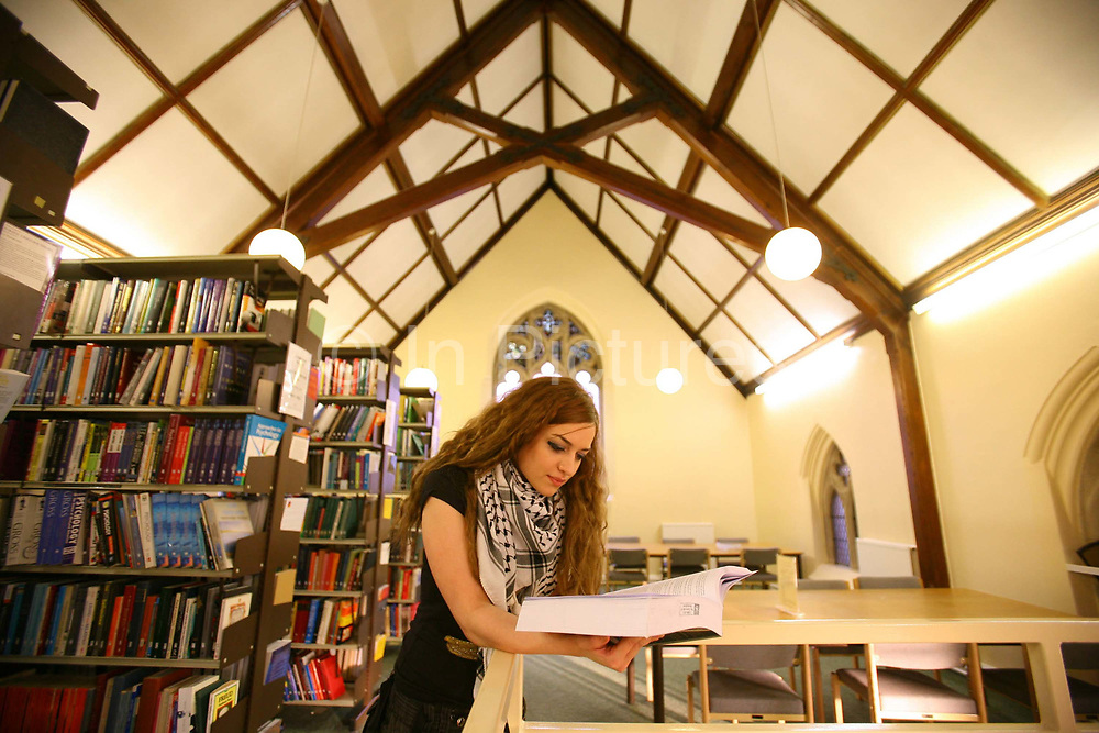 Sandra Alrisheq , 21 year old Palestinian studyng law at the University of Buckingham reads in the Franciscan library. The University of Buckingham is unique. It is the only independent university in the UK with a Royal Charter, and probably the smallest with just around 1000 students. Honours degrees are achieved in two intensive years of study. The University campus is well known for being one of the most attractive locations in the region. The Great Ouse river, home to much wildlife, winds through the heart of our campus. Much of our teaching takes place in our restored buildings. Each student mixes with 89 other different nationalities and so being at Buckingham is just like being in a mini global village.