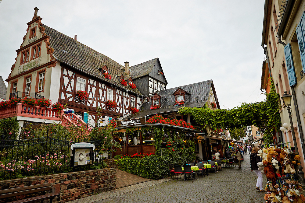 View outside of the Wizerkeller Restaurant and Cafe Terrasse, and Market, Rüdesheim, Germany (Horizontal).