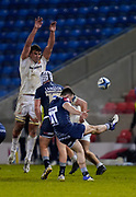 Exeter Chiefs lock Sam Skinner  jumps in an attempt to charge down a clearance kick from Sale Sharks Raffi Quirke during a Gallagher Premiership Round 11 Rugby Union match, Friday, Feb 26, 2021, in Eccles, United Kingdom. (Steve Flynn/Image of Sport)