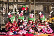 "05 DECEMBER 2020 - INDIANOLA, IOWA: Children dressed as Christmas elves work on toys in ""Santa's Workshop"" during a drive through visit with Santa Claus. About 500 children visited Santa Claus and Mrs. Claus in Indianola Saturday. The town has hosted Santa on the town square for the last seven years but the COVID-19 (SARS-Cov-2) pandemic forced organizers to move the event to the parking lot of a local hardware store and do it ""drive through"" style. Iowa has one of the highest Coronavirus test rates in the United States.        PHOTO BY JACK KURTZ"