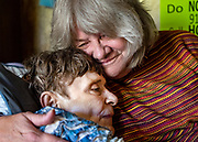 """Lori Simonian, 65, right, hugs her terminally ill half-sister Judy Morrow, 74, left, at Morrow's home in Clarkston, Washington on Thursday, Oct. 10, 2019. The pair, who share a birth mother, finally found each other through ancestry.com with the help of Morrow's granddaughter, Kendall Prince, in January of 2019 and met for the first time this month. """"I'm so happy, because I have the best baby sister in the world. I just wish we had met sooner,"""" said Morrow."""