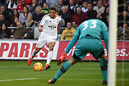 Jefferson Montero of Swansea city looks to beat Petr Cech, the Arsenal goalkeeper. Barclays Premier league match, Swansea city v Arsenal  at the Liberty Stadium in Swansea, South Wales  on Saturday 31st October 2015.<br /> pic by  Andrew Orchard, Andrew Orchard sports photography.