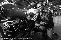 """Sean Duggan working on his 1936 Harley-Davidson Knucklehead chopper on the Friday """"Rest Day"""" between stages 7 and 8 of the Motorcycle Cannonball Cross-Country Endurance Run in Junction City, KS., USA. Friday, September 12, 2014.  Photography ©2014 Michael Lichter."""
