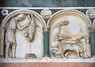 Late medieval relief sculpture depicting the labours for December and November and astrological signs on the Facade of the Cattedrale di San Martino,  Duomo of Lucca, Tunscany, Italy, .<br /> <br /> Visit our ITALY HISTORIC PLACES PHOTO COLLECTION for more   photos of Italy to download or buy as prints https://funkystock.photoshelter.com/gallery-collection/2b-Pictures-Images-of-Italy-Photos-of-Italian-Historic-Landmark-Sites/C0000qxA2zGFjd_k<br /> <br /> <br /> Visit our MEDIEVAL PHOTO COLLECTIONS for more   photos  to download or buy as prints https://funkystock.photoshelter.com/gallery-collection/Medieval-Middle-Ages-Historic-Places-Arcaeological-Sites-Pictures-Images-of/C0000B5ZA54_WD0s .<br /> <br /> If you prefer to buy from our ALAMY PHOTO LIBRARY  Collection visit : https://www.alamy.com/portfolio/paul-williams-funkystock/lucca.html .