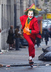"Joaquin Phoenix in full costume as the Clown Prince of Crime super villain the Joker, is seen filming additional scenes for an intense action chase sequence Sunday morning for the upcoming movie ""JOKER"" with costars Shea Whigham and Bill Camp as the scene involved The Joker running away from two Gotham Police Detectives on a very gritty and seedy look under an elevated train track Subway Station in the Bronx. 25 Nov 2018 Pictured: Joaquin Phoenix. Photo credit: LRNYC / MEGA TheMegaAgency.com +1 888 505 6342"
