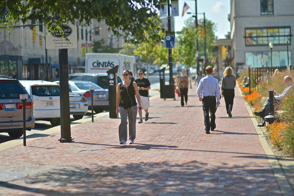 Pedestrians walking downtown outside of Lock 3.