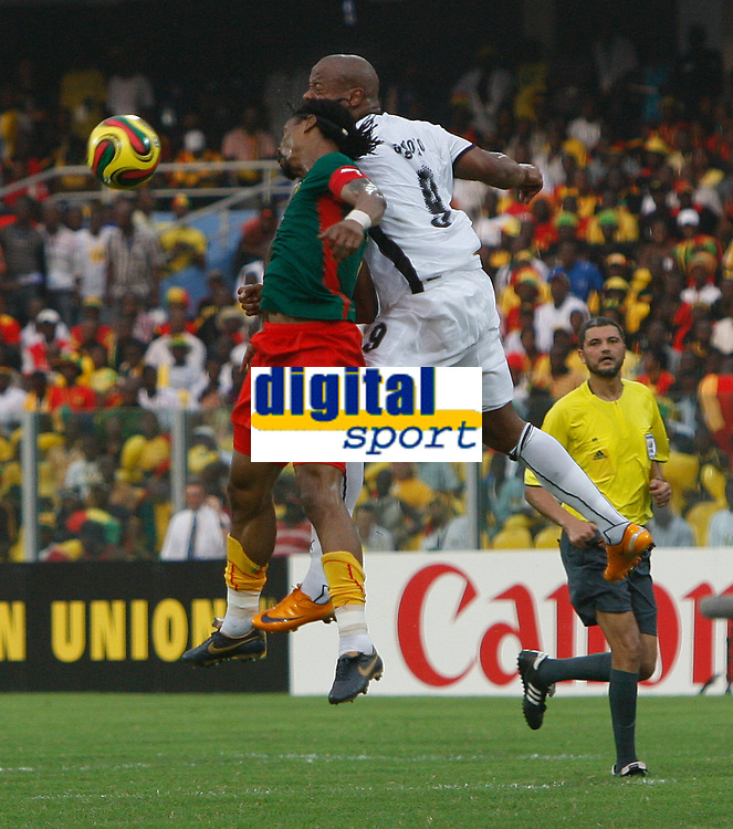 Photo: Steve Bond/Richard Lane Photography.<br />Ghana v Cameroon. Africa Cup of Nations. 07/02/2008. Junior Agogo (L) in an aerial challange with Rigobert Song (L)