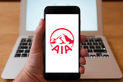 Using iPhone smartphone to display logo of  AIA pan-Asian insurance group