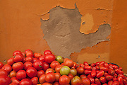 Tomatoes displayed at a food stall on a street in La Viña quarter, Cadiz, Andalucía, Spain.