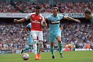 Alex Oxlade-Chamberlain of Arsenal is challenged by Mark Noble of West Ham United. Barclays Premier League, Arsenal v West Ham Utd at the Emirates Stadium in London on Sunday 9th August 2015.<br /> pic by John Patrick Fletcher, Andrew Orchard sports photography.