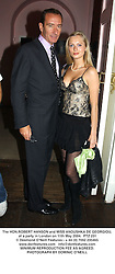 The HON.ROBERT HANSON and MISS ANOUSHKA DE GEORGIOU, at a party in London on 11th May 2004.PTZ 231