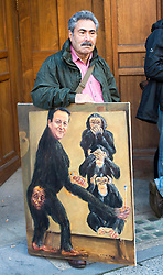 A protester outside the High Court as Prime Minister David Cameron arrives at the Leveson Inquiry in London, Thursday, 14th June 2012.  Photo by: i-Images