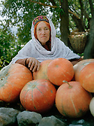 Hunza pumkins and a lady with hair dyed with henne.