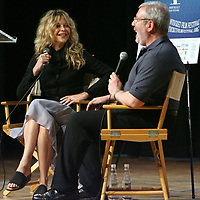 """(06/21/08-Nantucket,MA) Nantucket Film Festival. Here, actress Meg Ryan at Nantucket High School for an early afternoon show entitled """"Compass Rose Acting Tribute"""" where the stars were interviewed/roasted by film critic Leonard Maltin (at right). Photo by Mark Garfinkel"""