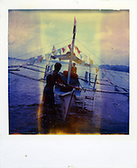 Old Polaroid of two Filipino men preparing a boat for a contest, Palawan Island, Philippines, Southeast Asia