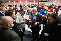 © Licensed to London News Pictures . 04/02/2017 . Liverpool, UK . JEREMY CORBYN signs a supporter's bag . Labour Party leader Jeremy Corbyn and Shadow Chancellor John McDonnell launch the party's first regional economic conference at the Devonshire House Hotel . Photo credit : Joel Goodman/LNP