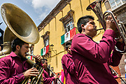 A brass band marches through the streets during a children's parade celebrating Mexican Independence Day celebrations September 17, 2017 in San Miguel de Allende, Mexico.