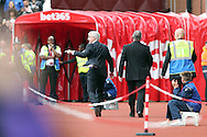 Stoke City Manager Mark Hughes reacts pointing as he heads towards the tunnel after being sent off to the stands during the game. Premier league match, Stoke City v Tottenham Hotspur at the Bet365 Stadium in Stoke on Trent, Staffs on Saturday 10th September 2016.<br /> pic by Chris Stading, Andrew Orchard sports photography.
