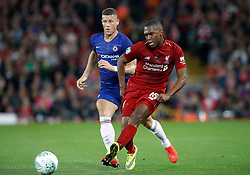 Chelsea's Ross Barkley (left) and Liverpool's Daniel Sturridge battle for the ball during the Carabao Cup, Third Round match at Anfield, Liverpool.