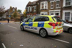 © Licensed to London News Pictures. 24/10/2020. London, UK. Police car at a crime scene on Westbury Road in Walthamstow, East London following the death of a 22 year old man. The victim was stabbed on Friday and was pronounced dead at the scene just before 10pm.  Photo credit: Dinendra Haria/LNP