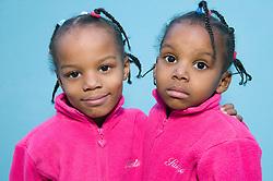 Portrait of twin sisters,