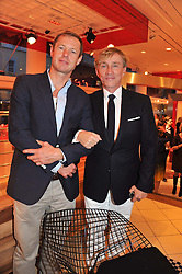 Left to right, brothers TOM CONRAN and JASPER CONRAN at an exhibition at The Conran Shop entitled Red to celebrate 25 years of The Conran Shop at the Michelin Building, 81 Fulham Road, London on 19th September 2012.