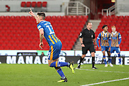 13 James Bolton celebrates the first goal for Shrewsbury Town during the The FA Cup 3rd round replay match between Stoke City and Shrewsbury Town at the Bet365 Stadium, Stoke-on-Trent, England on 15 January 2019.