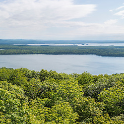 View of the East Grand Lake forest from Peek-A-Boo Mountain in Weston, Maine. Brackett Lake is in the middle of the photo, East Grand Lake in the distance.