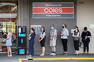 People line up outside Coles at Plympton. New COVID Lockdown Restrictions announced today by the SA Premier Steven Marshall caused panic shopping at supermarkets as people stocked up with essential groceries.   (Photo by Peter Mundy/Speed Media)