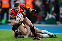 Saracens Outside Centre (#13) Joel Tomkins is tackled during the second half of the match - Photo mandatory by-line: Rogan Thomson/JMP - Tel: Mobile: 07966 386802 16/02/2013 - SPORT - RUGBY - Allianz Park - Barnet. Saracens v Exeter Chiefs - Aviva Premiership. This is the first Premiership match at Saracens new home ground, Allianz Park, and the first time Premiership Rugby has been played on an artificial turf pitch.