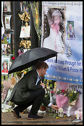August 30, 2017 - London, London, United Kingdom - Image licensed to i-Images Picture Agency. 30/08/2017. London, United Kingdom. Prince Harry lay flowers given to him  by members of the public outside the gates of Kensington Palace in London on the eve of the twentieth anniversary of the death of Princess Diana.  Picture by Stephen Lock / i-Images (Credit Image: © Stephen Lock/i-Images via ZUMA Press)