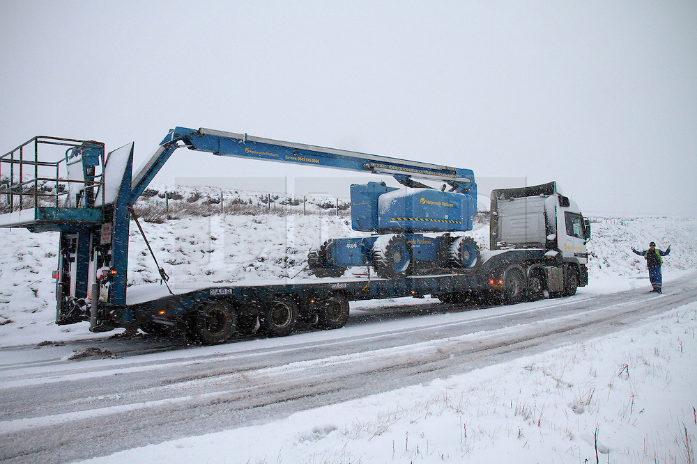 © Licensed to London News Pictures. 27/01/2012. Derbyshire, UK. An HGV carrying an 18 tonne cherry picker stranded on the  Peak District's notorious Snake Pass Road between Manchester and Sheffield on January 27th, 2012, following heavy snow. Photo credit : Joel Goodman/LNP