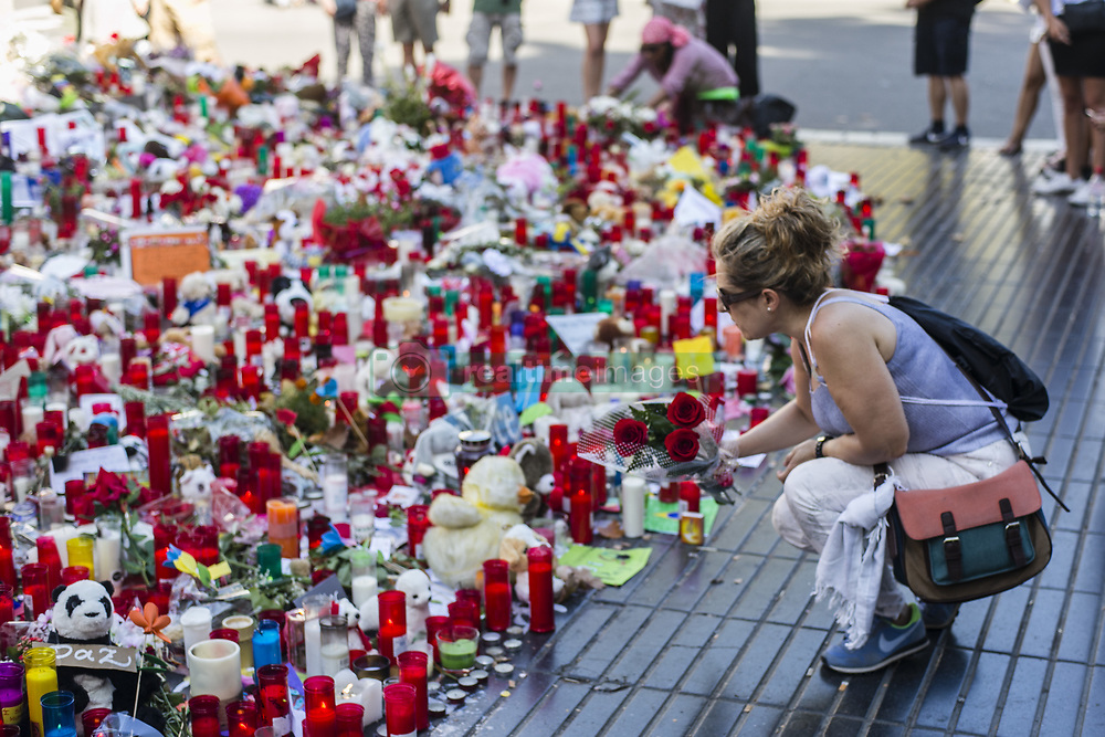 August 22, 2017 - Barcelona, Spain - People place flowers, candles, balloons and many objects to pay tribute to the victims of the Barcelona and Cambrils attacks on the Rambla boulevard in Barcelona, five days after the Barcelona and Cambrils attacks that killed 15 people. (Credit Image: © Xavier Bonilla/NurPhoto via ZUMA Press)