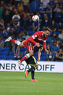 Juan Cala of Cardiff city tumbles over Jelle Vossen of Middlesbrough . Skybet football league championship match, Cardiff city v Middlesbrough at the Cardiff city stadium in Cardiff, South Wales on Tuesday 16th Sept 2014<br /> pic by Andrew Orchard, Andrew Orchard sports photography.