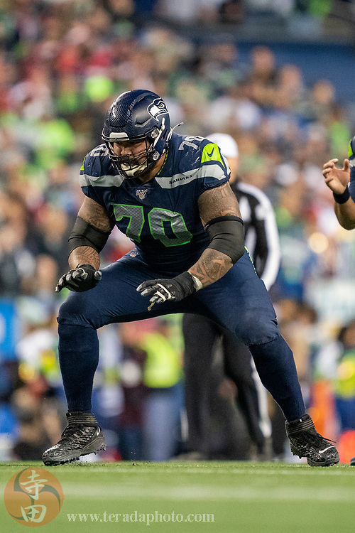 December 29, 2019; Seattle, Washington, USA; Seattle Seahawks offensive guard Mike Iupati (70) during the fourth quarter against the San Francisco 49ers at CenturyLink Field.