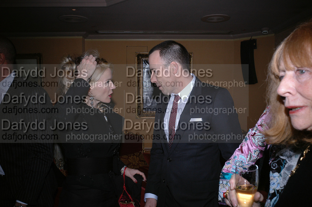 Daphne Guinness and David Furnish, Valentino couture show, Ecole Nationale Superiore des Beaux -Arts, rue Bonaparte. After party at the Ritz. 23 January  2006.  ONE TIME USE ONLY - DO NOT ARCHIVE  © Copyright Photograph by Dafydd Jones 66 Stockwell Park Rd. London SW9 0DA Tel 020 7733 0108 www.dafjones.com