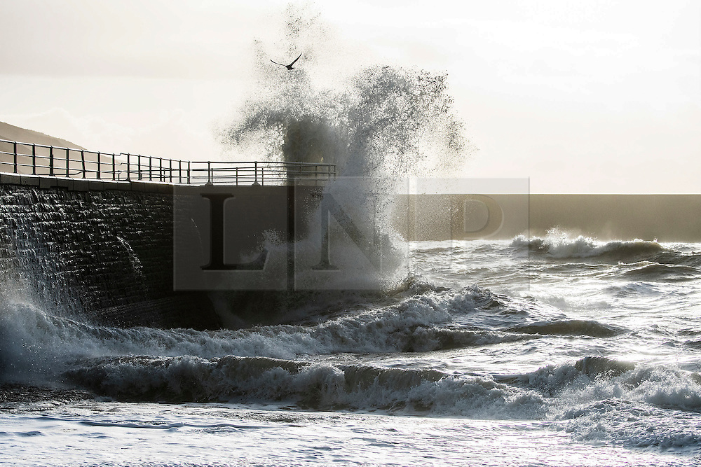 © London News Pictures. 22/12/2016. Aberystwyth, UK. Waves batter the seafront and harbour wall at Aberystwyth as Storm Barbara clips the the Cardigan Bay coast of the Irish Sea. Strong winds and damp weather are due to hits the west coast and northern parts of the UK over the Christmas period.  Photo credit: Keith Morris/LNP