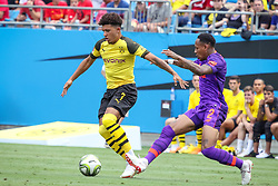 July 22, 2018 - Charlotte, North Carolina, USA - Borussia Dortmund midfielder Jadon Sancho (7) and Liverpool defender Nathaniel Clyne (2) during an International Champions Cup match at Bank of America Stadium in Charlotte, NC.  Borussia Dortmund of the German Bundesliga beat Liverpool of the English Premier League 3 to 1. (Credit Image: © Jason Walle via ZUMA Wire)