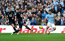 Manchester City's Sergio Aguero crosses the ball into the box - Photo mandatory by-line: Dougie Allward/JMP - Tel: Mobile: 07966 386802 24/11/2013 - SPORT - Football - Manchester - Etihad Stadium - Manchester City v Tottenham Hotspur - Barclays Premier League