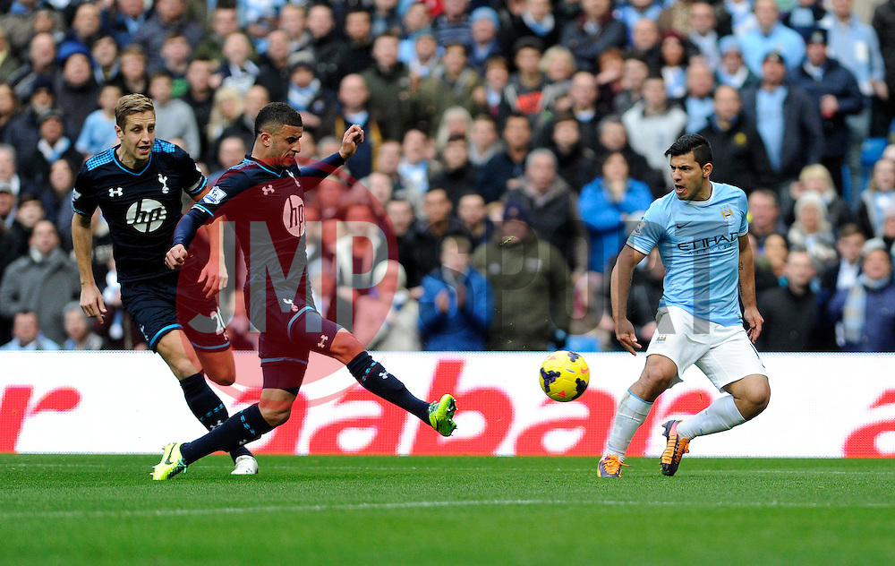 Manchester City's Sergio Aguero crosses the ball into the box - Photo mandatory by-line: Dougie Allward/JMP - Tel: Mobile: 07966 386802 24/11/2013 - SPORT - Football - Manchester - Etihad Stadium - Manchester City v Tottenham Hotspur - Barclays Premier League