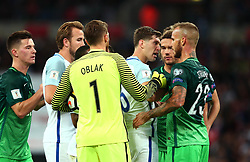 John Stones of England squares up to Aljaz Struna of Slovenia - Mandatory by-line: Robbie Stephenson/JMP - 05/10/2017 - FOOTBALL - Wembley Stadium - London, United Kingdom - England v Slovenia - World Cup qualifier