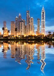 Futuristic skyline at night of new skyscrapers in Marina district of Dubai United Arab Emirates