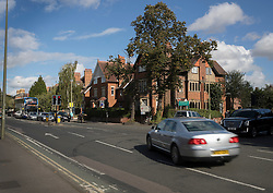 © Licensed to London News Pictures. 30/09/2016. Oxford, UK. Cars pass the junction of Banbury Road and Marston Ferry Road in the Summertown area of Oxford. A police hunt continues in Oxford for two men who abducted and raped a 14-year-old girl while she was on her way to school. The teenager was snatched and driven away from the Summertown area of Oxford at 8.25 on Wednesday morning. Photo credit: Peter Macdiarmid/LNP