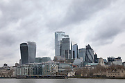 Grey storm clouds over the City of London on 25th February 2020 in London, United Kingdom. The City of London is a historic financial district, home to both the Stock Exchange and the Bank of England. Modern corporate skyscrapers tower above the vestiges of medieval alleyways below.